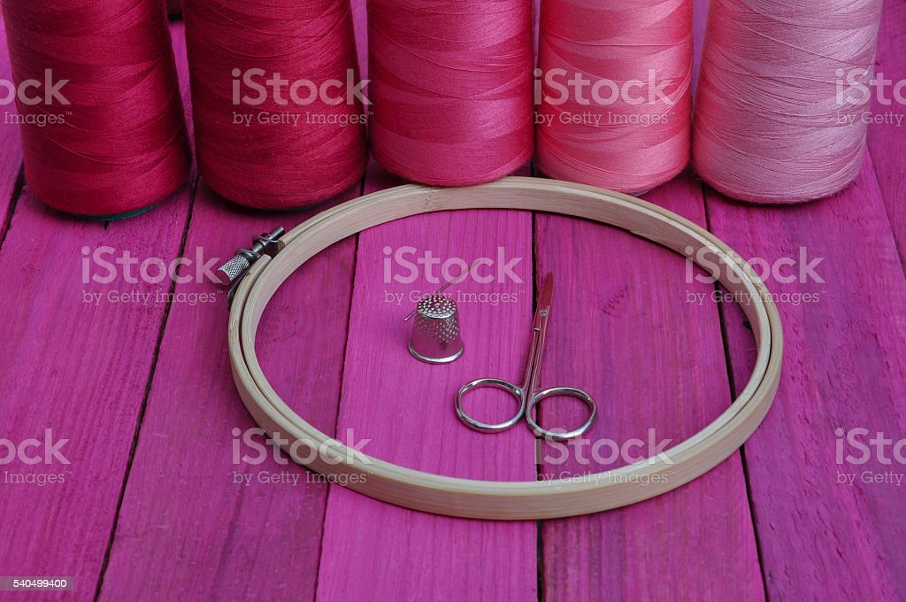 Several of red thread reel in a hoop stock photo