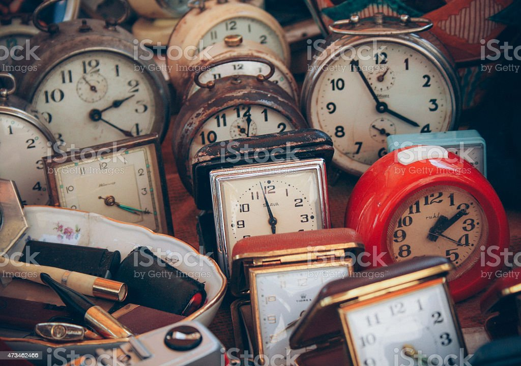 Several old clocks at an antique store stock photo