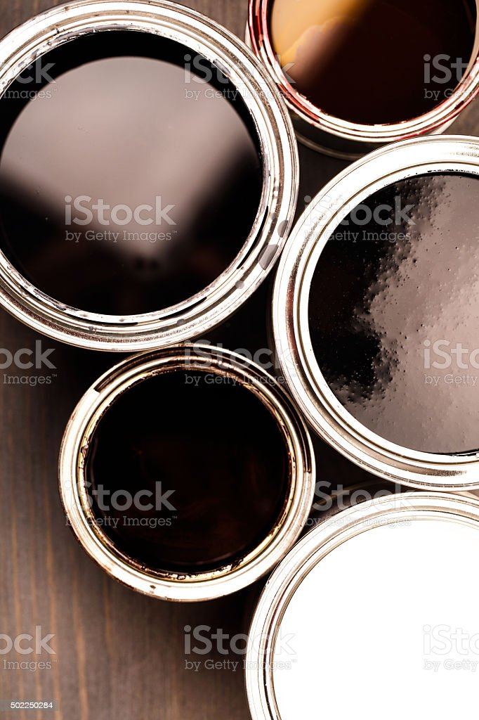 Several opend cans with paint inside stock photo