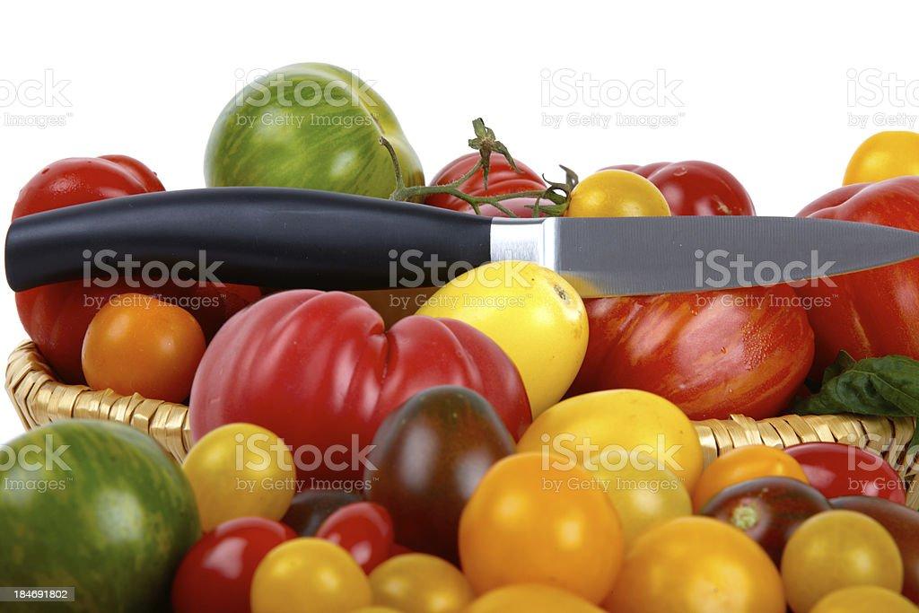 Several organic tomatoes stock photo