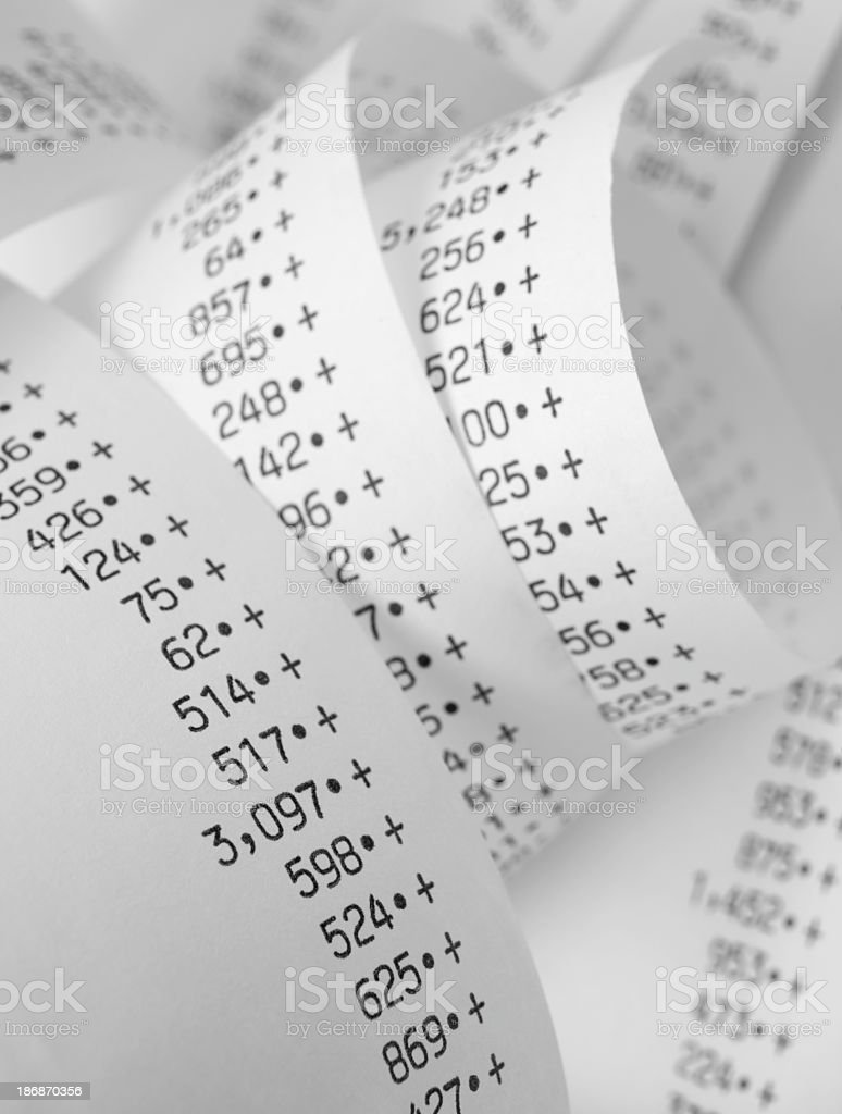 Several papers with spending numbers for accounting royalty-free stock photo