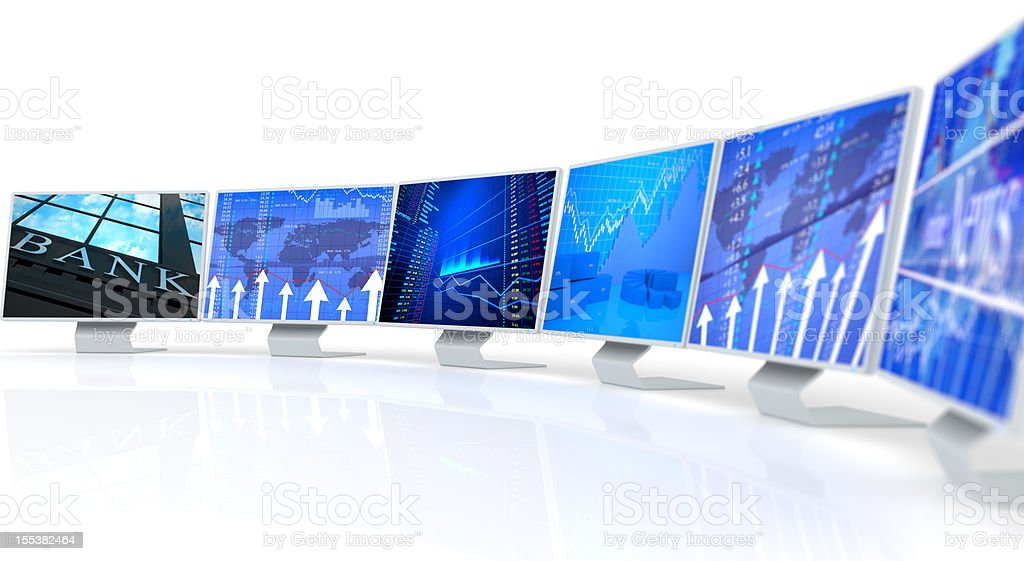 Several PC monitors displaying business charts and data royalty-free stock photo