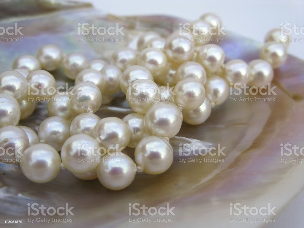 Several pearls on a shiny object stock photo