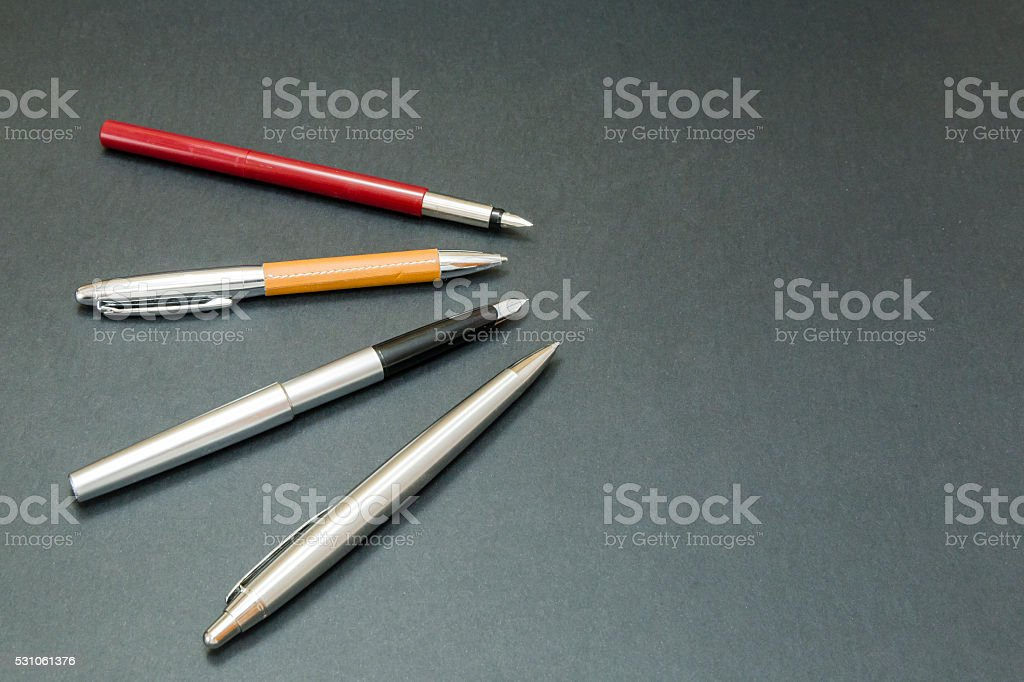 several pens and feathers stock photo