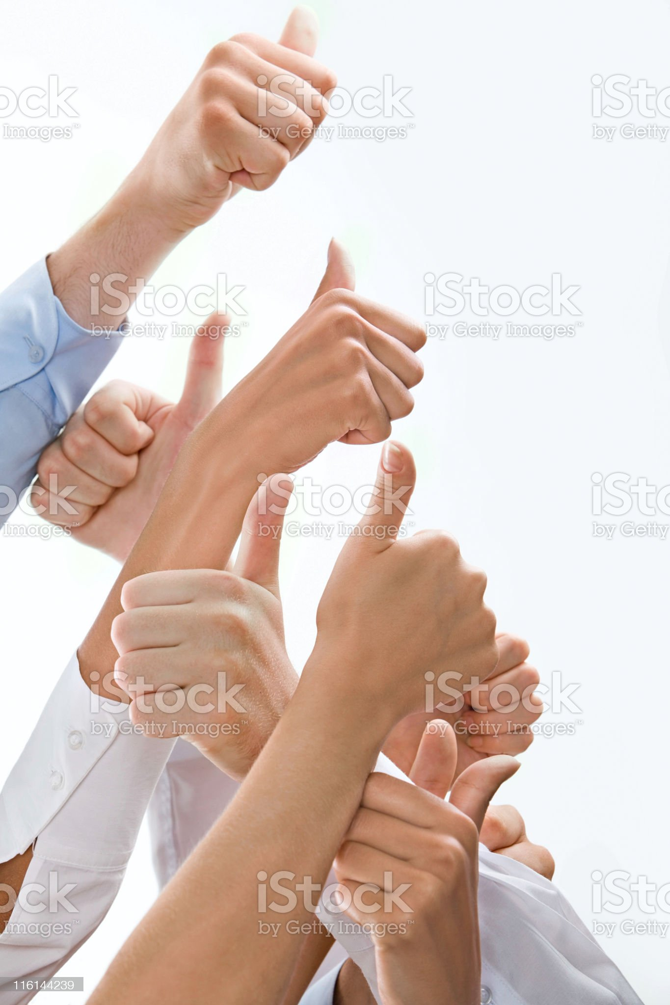 Several people giving the sign of okay with their thumbs up royalty-free stock photo