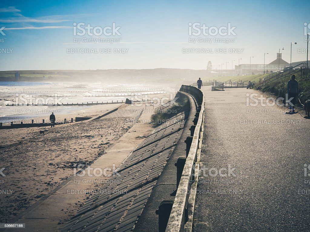 Several People Walking at Aberdeen Beach, UK stock photo