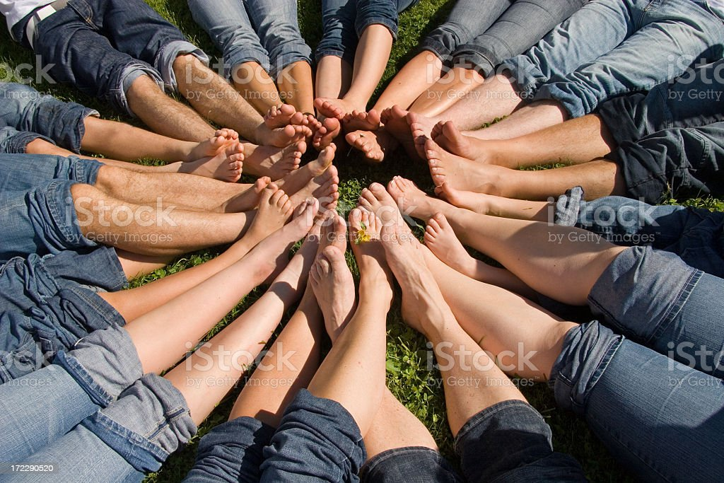 Several peoples feet joined to make a circle stock photo