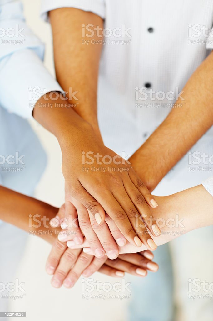 Several people's hands on top of each other creating a pile royalty-free stock photo