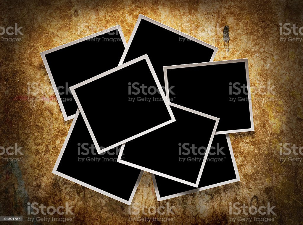 Several photographs on a grungy wooden background royalty-free stock photo