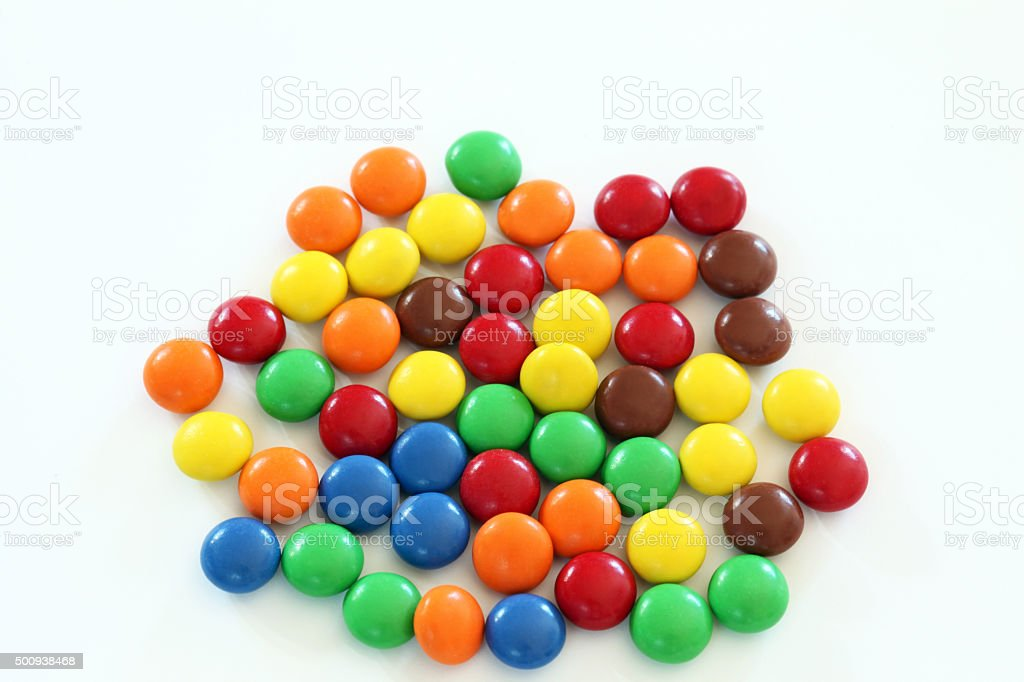 Several pieces chocolate candy. White background.  Many colors. stock photo