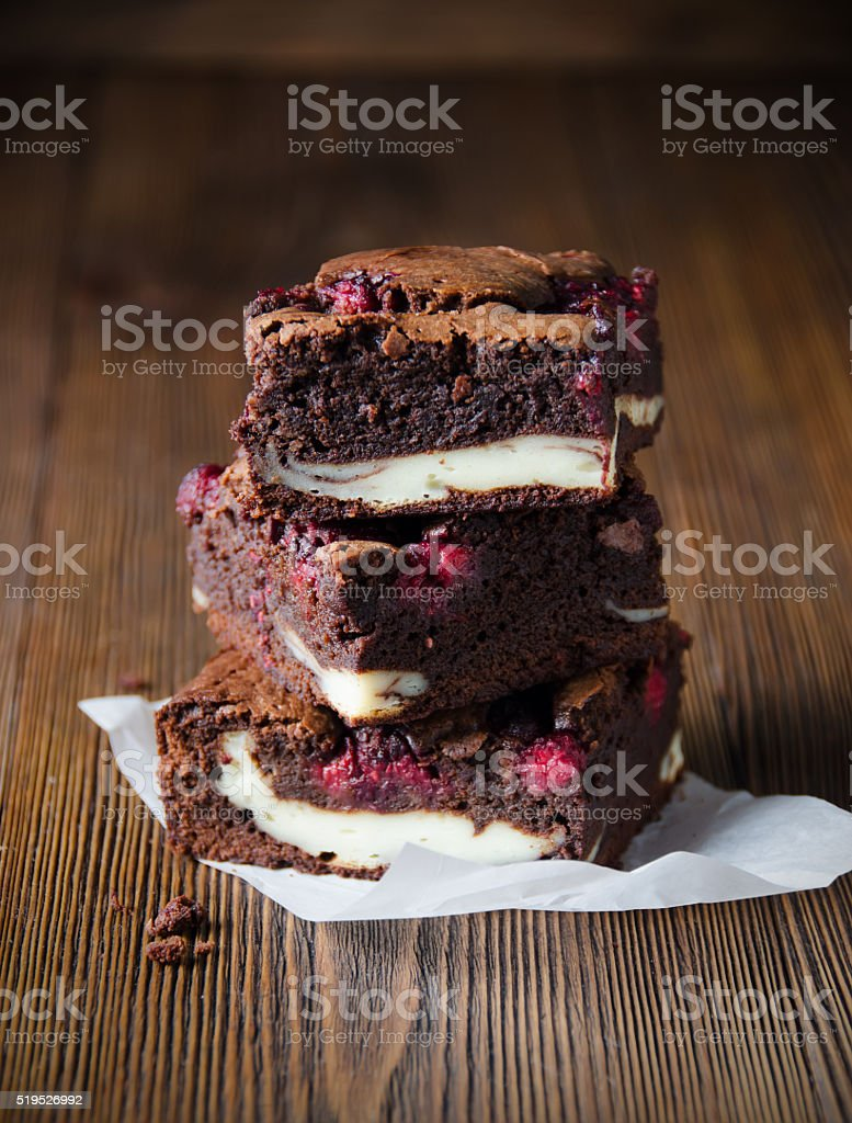Several pieces of raspberry brownie stock photo