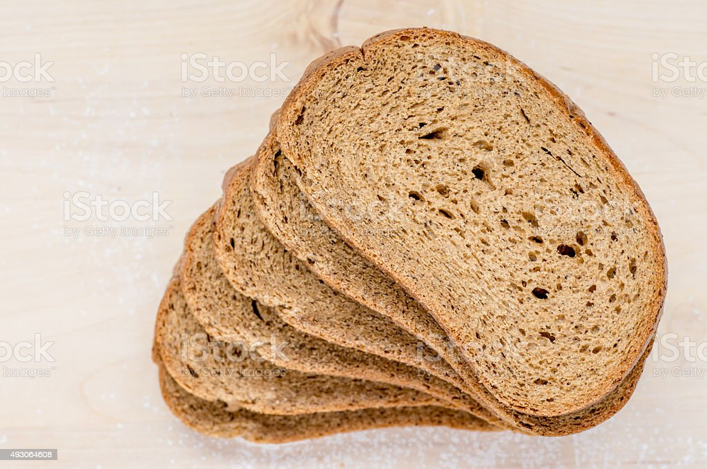 Several pieces of rye bread stock photo