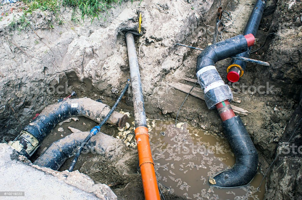 Several Pipes in the Earthen Trench  for Heating System stock photo