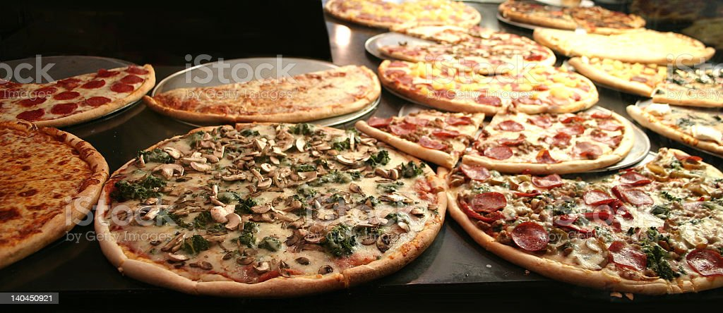Several pizzas with different toppings stock photo