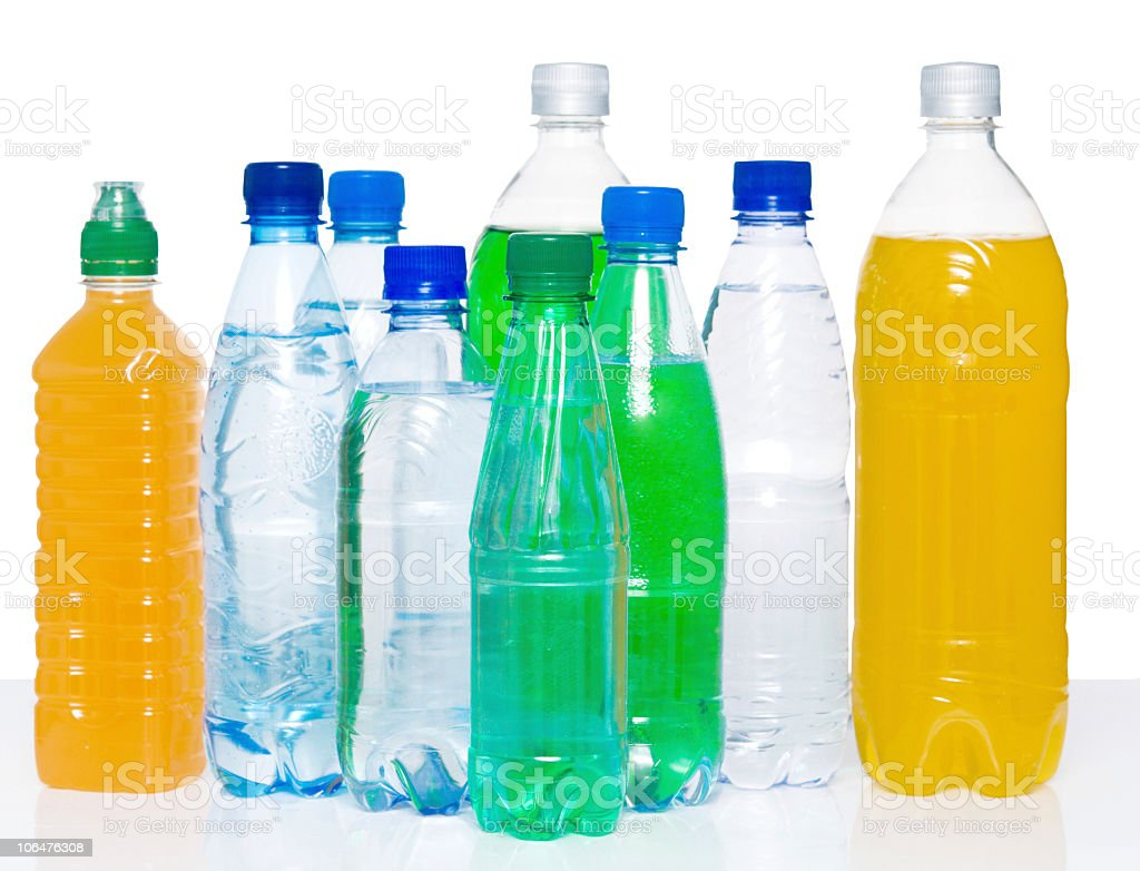 Several plastic bottles filled with various drinks royalty-free stock photo