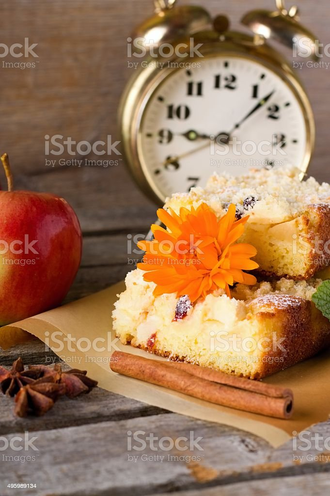 Several portions of apple pie with marigold bloom stock photo