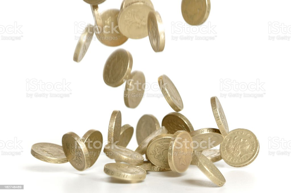 Several pound coins falling on white background stock photo