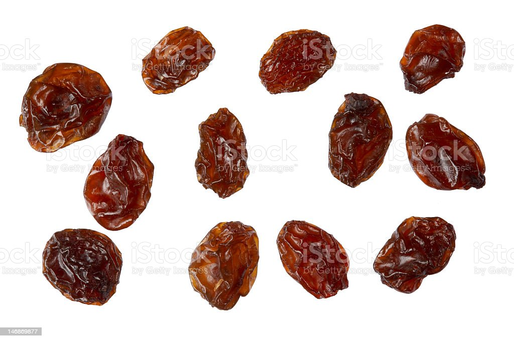 Several raisins isolated on white background stock photo
