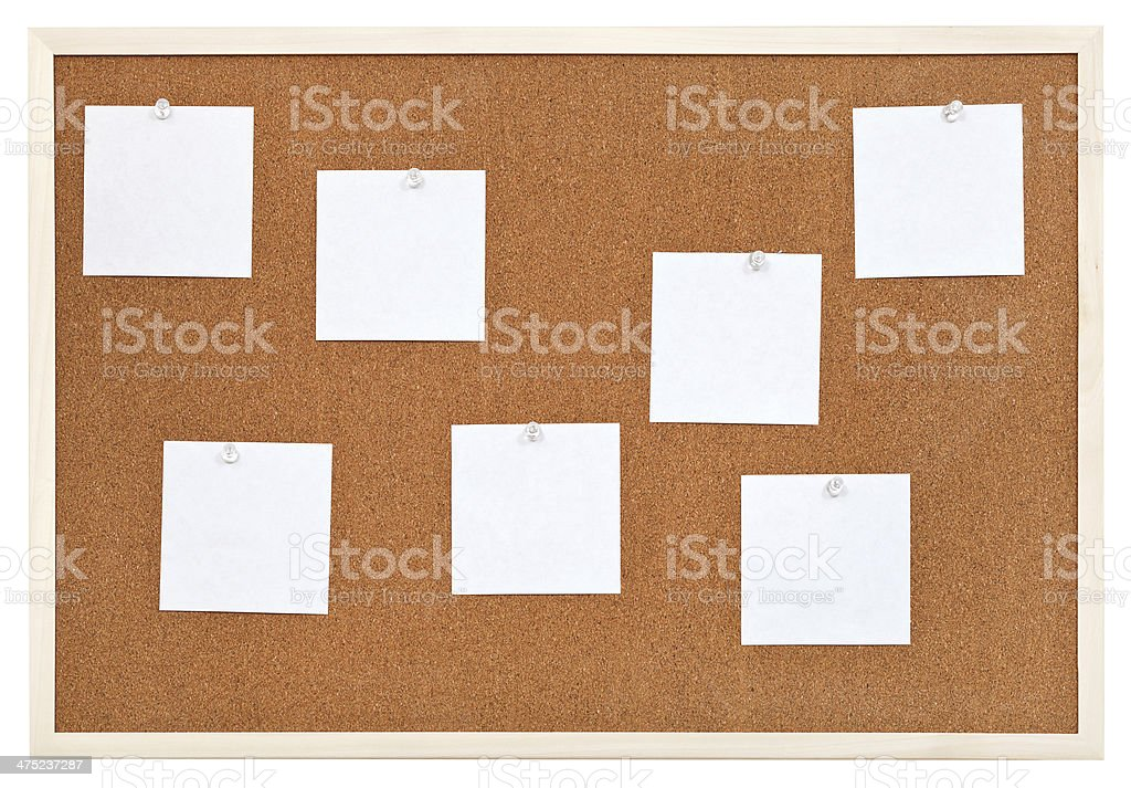 several sheets of paper on bulletin cork board royalty-free stock photo