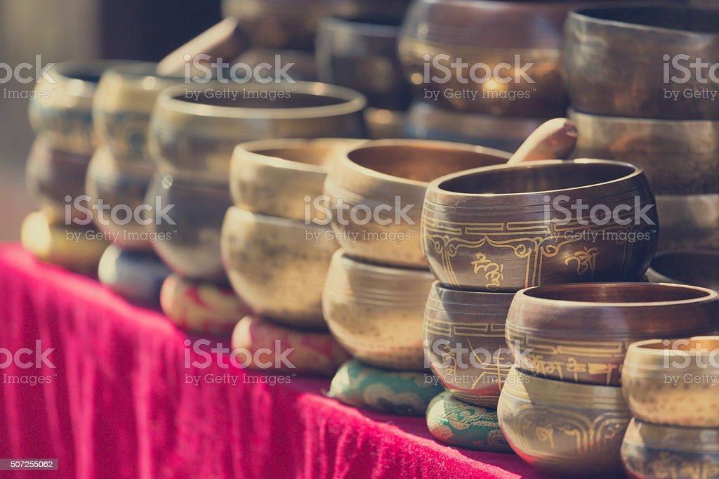 Several singing bowls displayed at a market in Kathmandu, Nepal stock photo