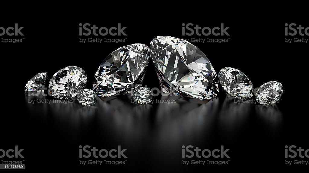 Several sizes of diamonds on a black background stock photo