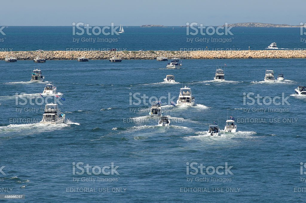 Several small fishing power boats heading out to sea. royalty-free stock photo