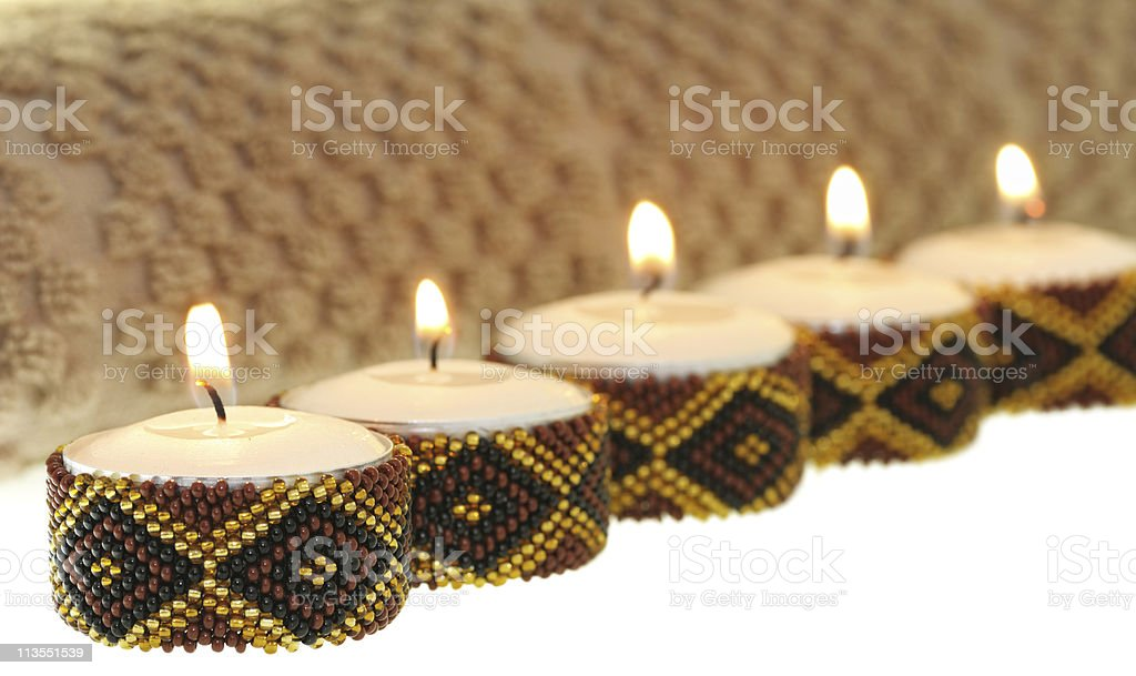 Several small spa candles with beaded diamond decoration stock photo