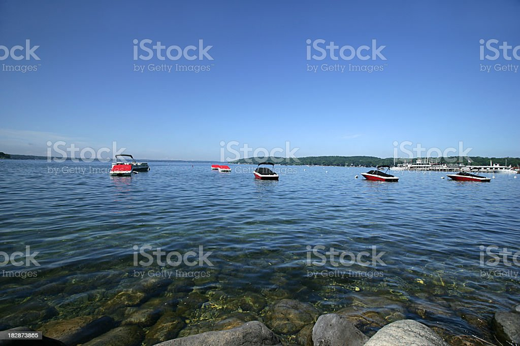 Several speedboats dock on the waters of Lake Geneva stock photo