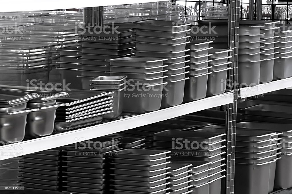 Several stacks of stainless steel pans royalty-free stock photo