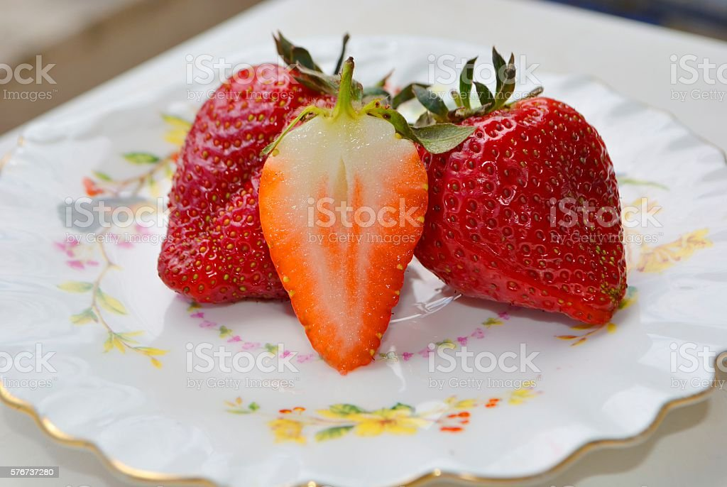 Several strawberries in a saucer stock photo