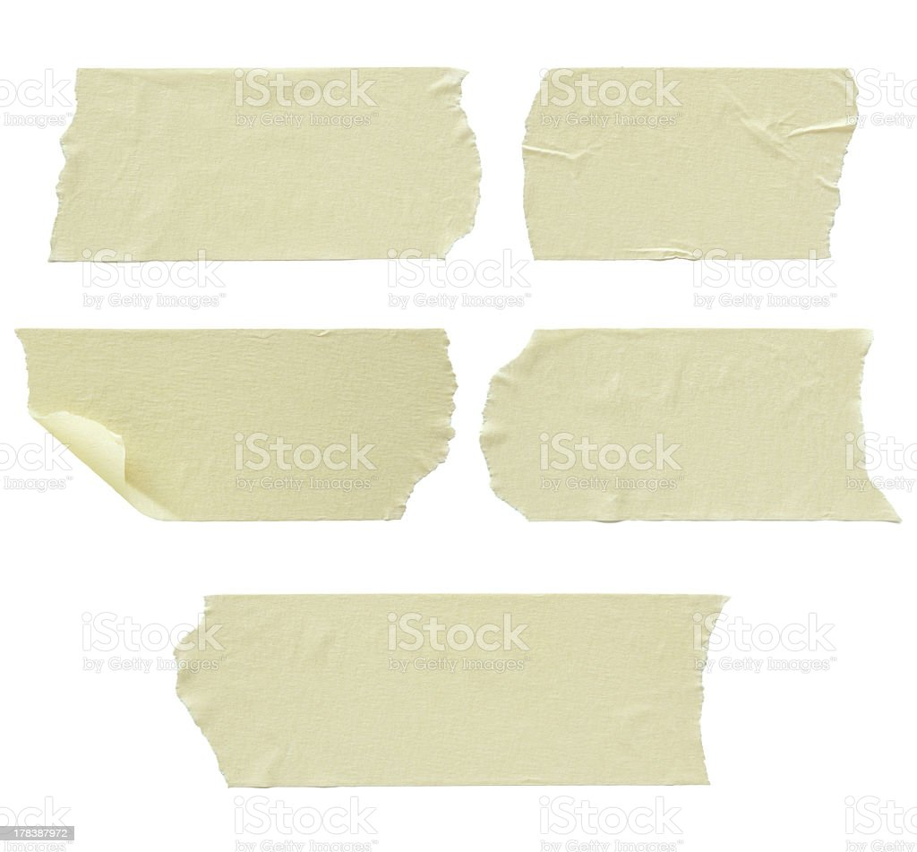 Several strips of masking tape varying lengths stock photo