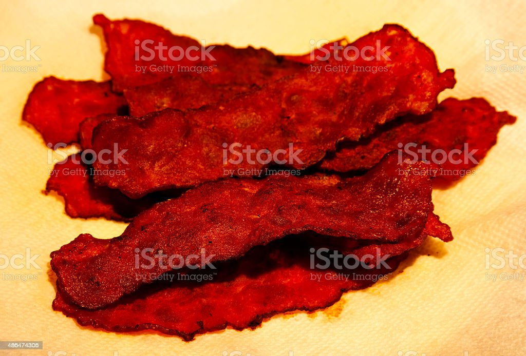 Several Strips Of Turkey Bacon On Yellow Paper Towel stock photo