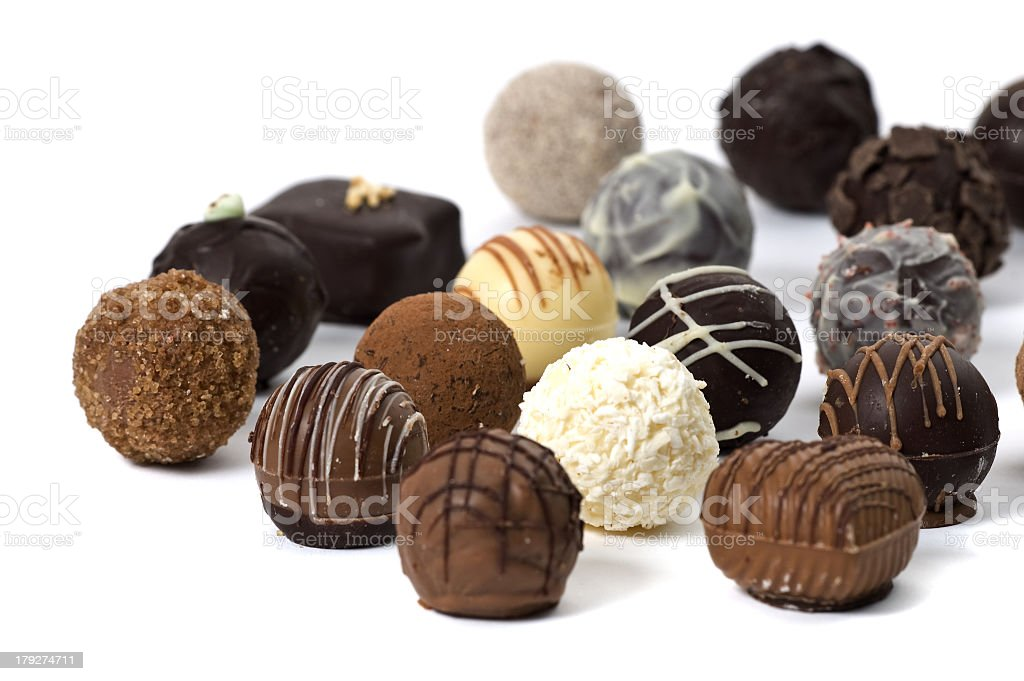 Several types and flavors of French candy on a white surface stock photo