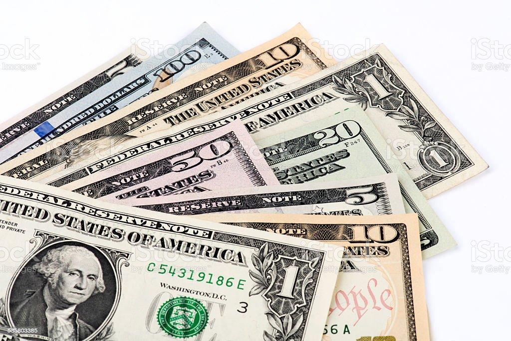 Several US Dollars on White Background stock photo