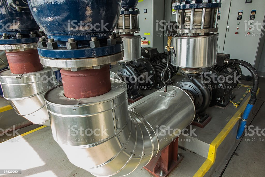 several water pumps with pipe stock photo