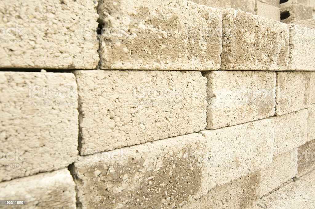 Several wet concrete blocks stacked on each other stock photo