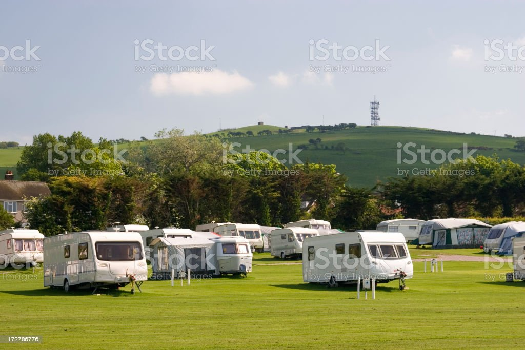 Several white caravans parked on green field royalty-free stock photo