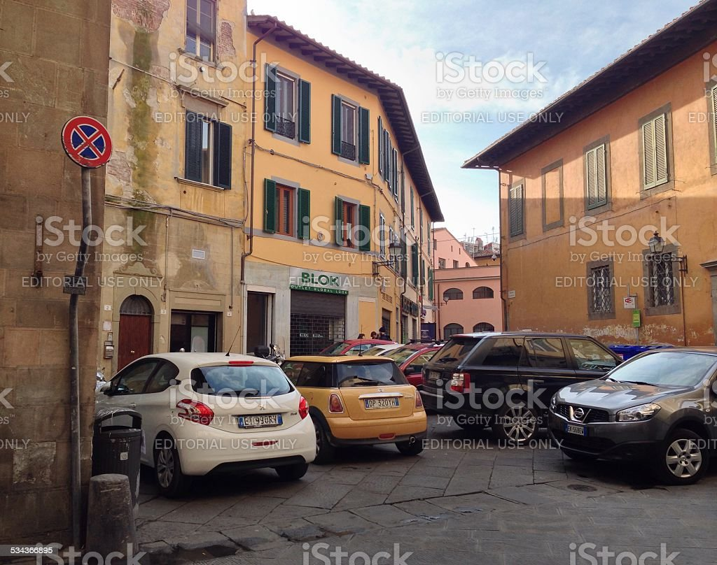 Several wildly parked cars in Italian town stock photo