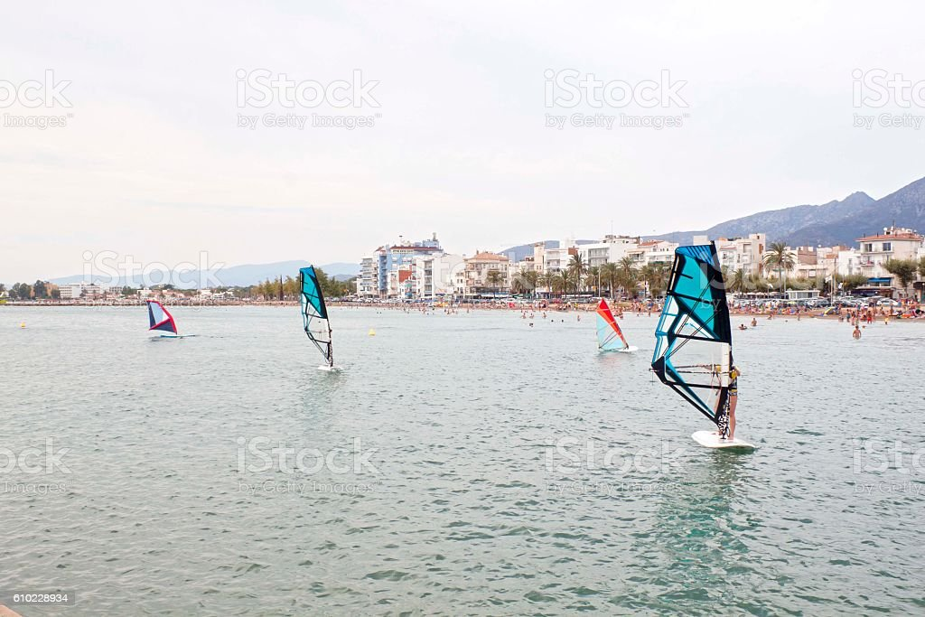 several windsurfers learning near the coast in the summer stock photo
