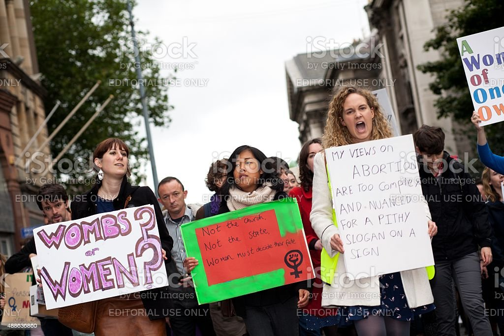 Several women holding informational posters regarding abortion stock photo