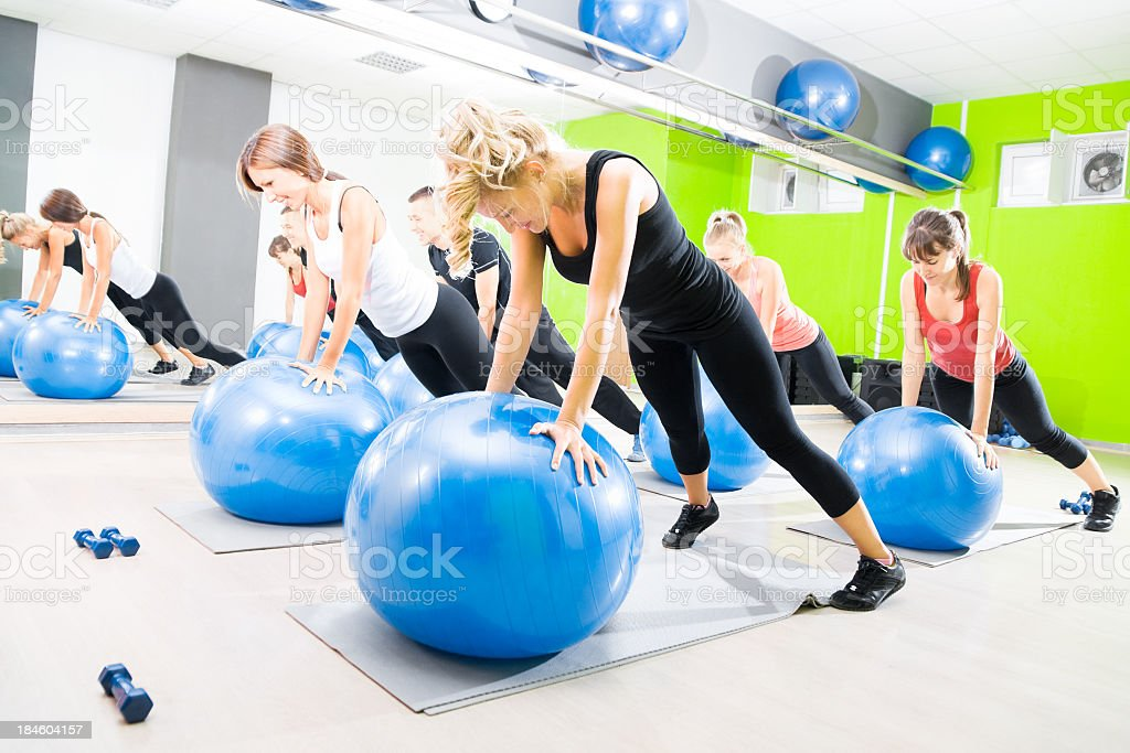 Several women taking part in a pilates class stock photo