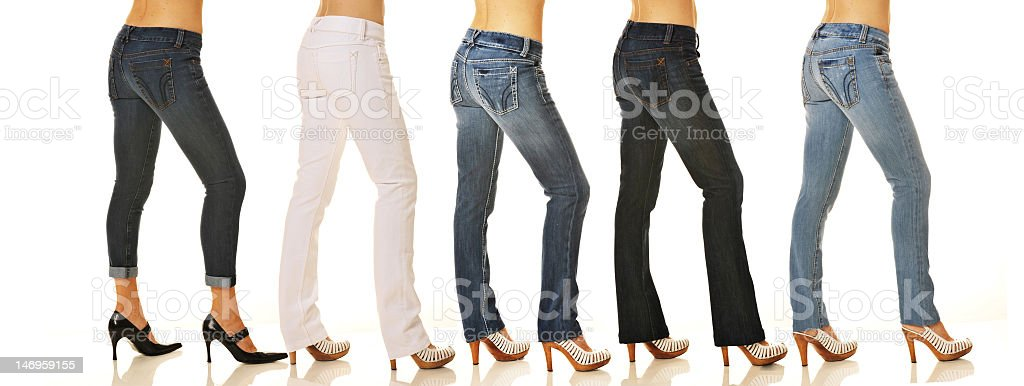 Several women wearing jeans and high heels against white royalty-free stock photo