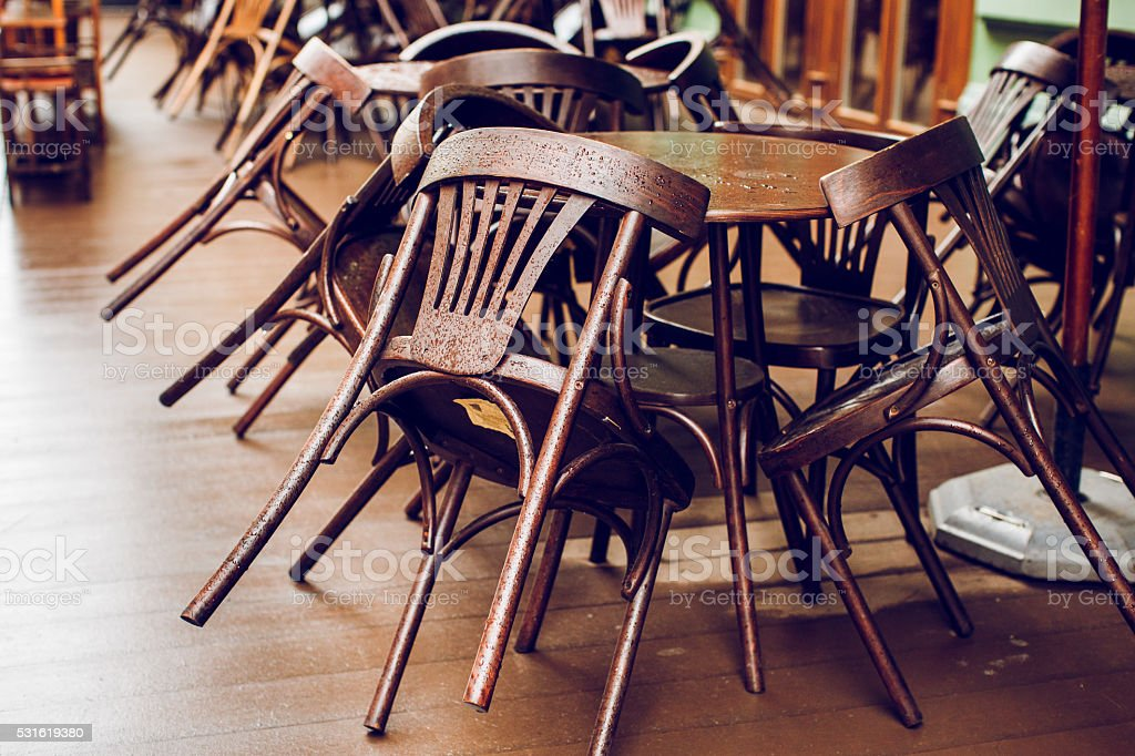 Several wooden chairs on the terrace stock photo