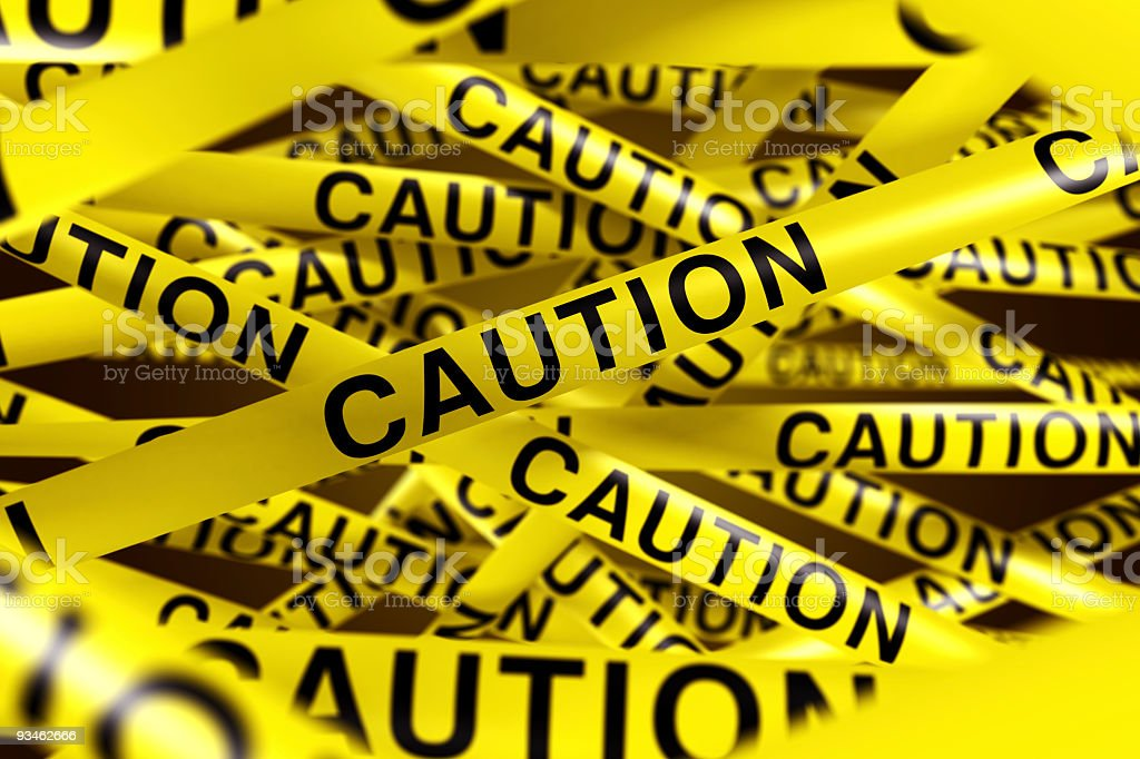 Several yellow caution tapes overload stock photo