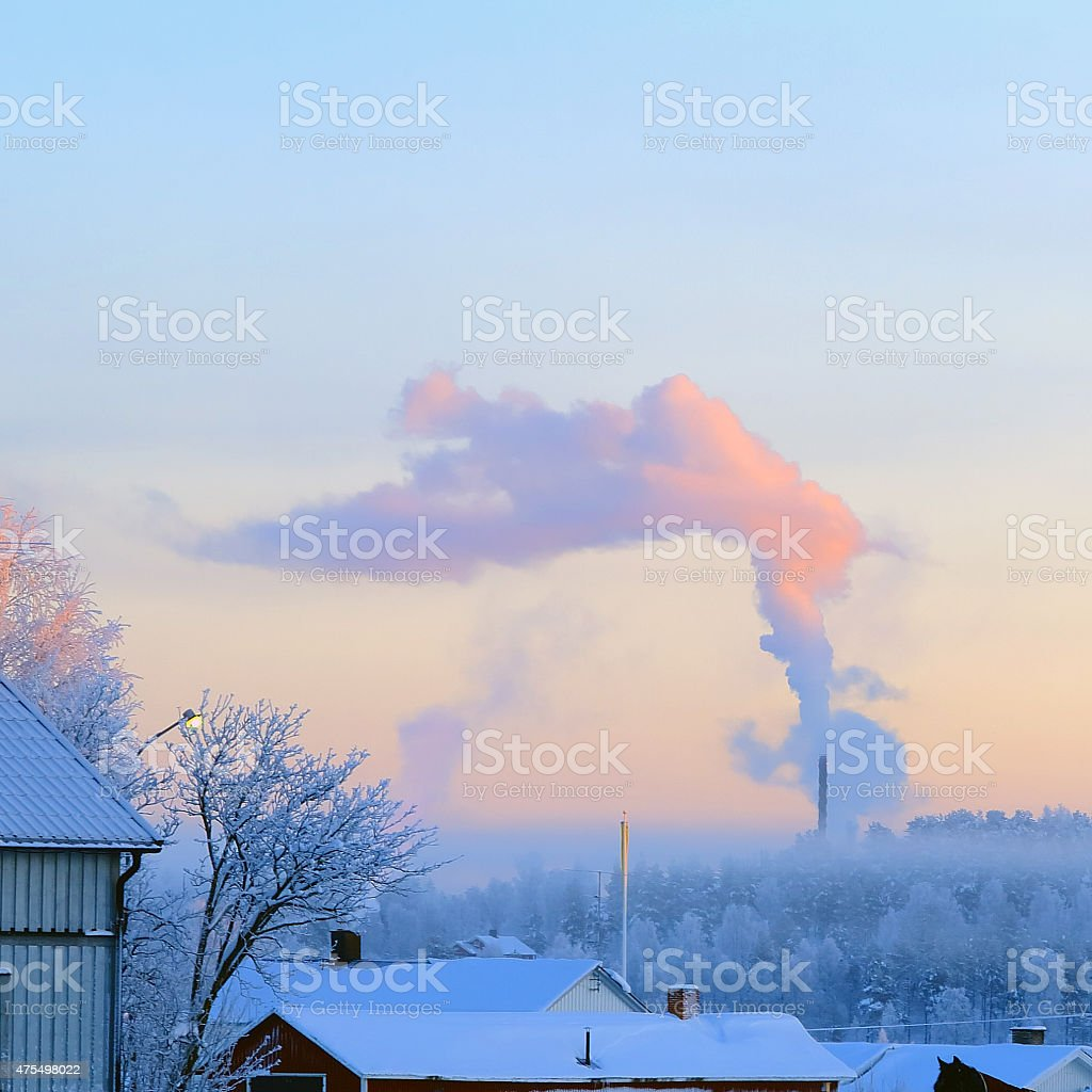 Severe cold and inversion prevents the smoke to rise stock photo