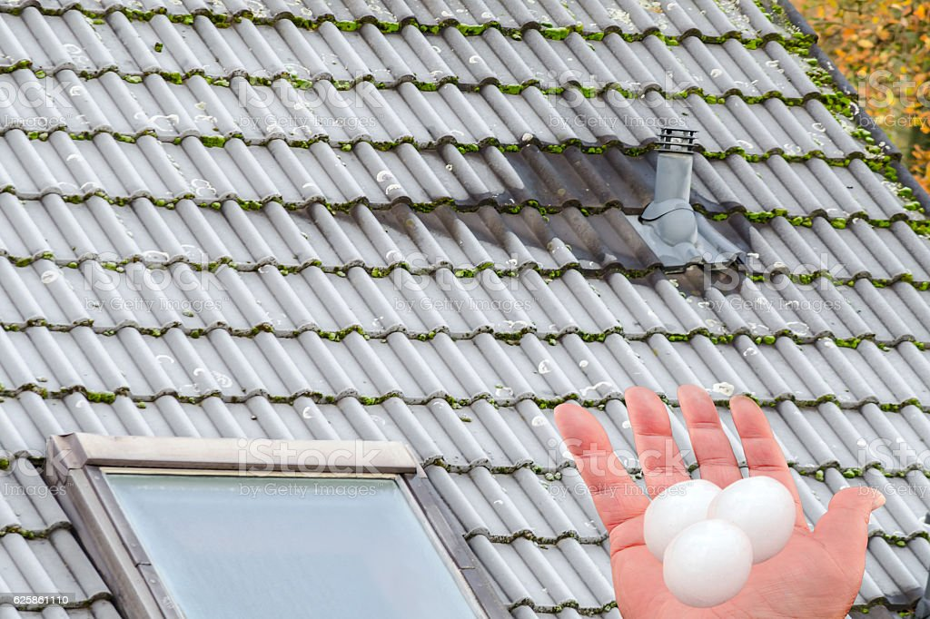 Severe damage to the roof by hail. stock photo