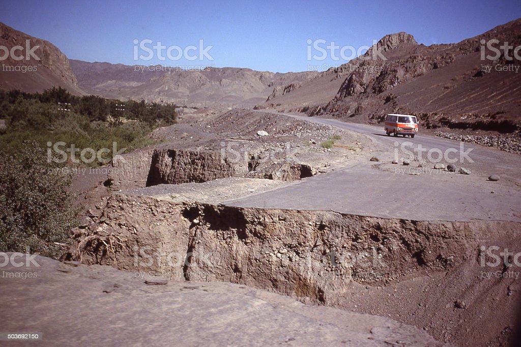 Severe erosion road damage Turfan Depression Xinjiang China East Asia stock photo