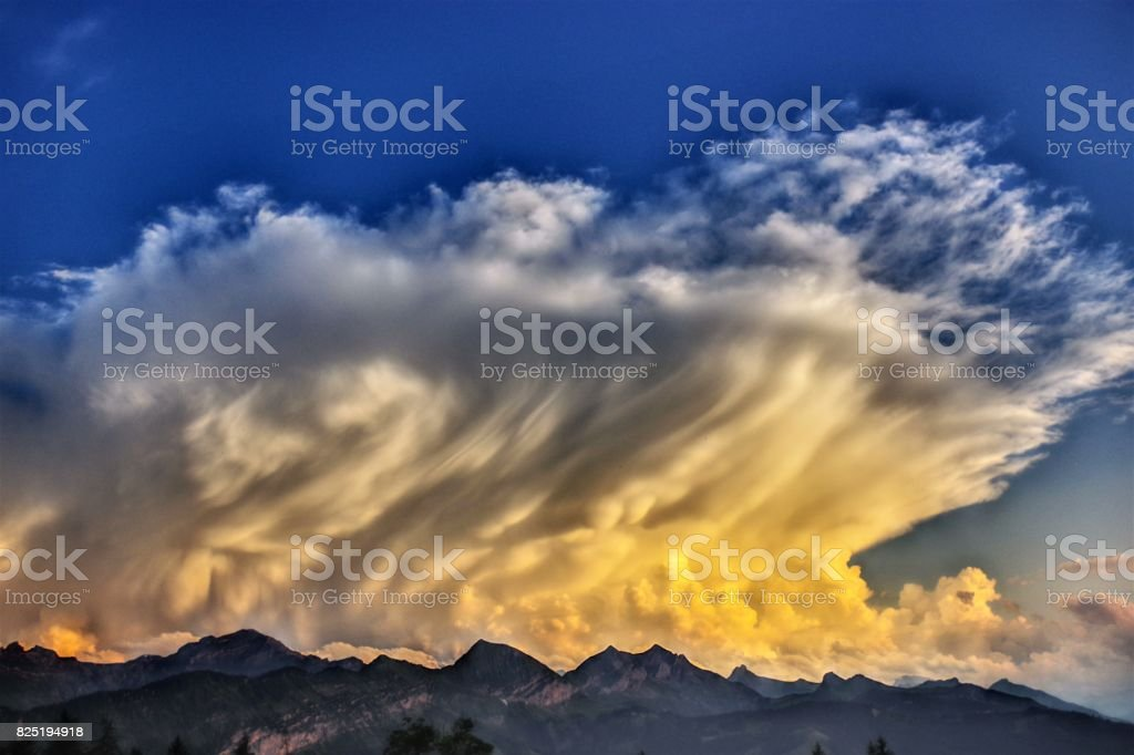 Severe Mammatus Storm Clouds over the Bernese Alps stock photo