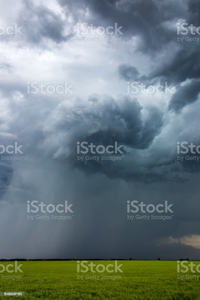Severe, rotating storm clouds with torrential rain shaft stock photo