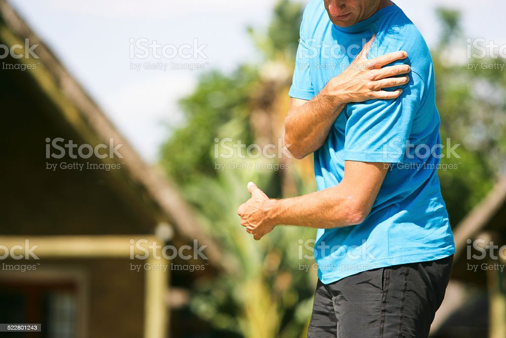 Severe shoulder pain stock photo